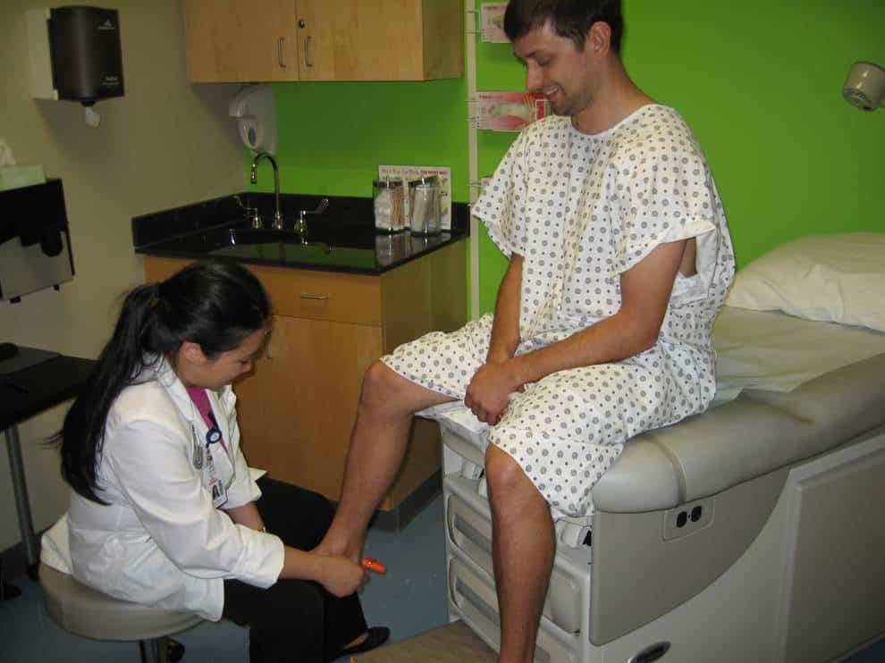 PA examining foot
