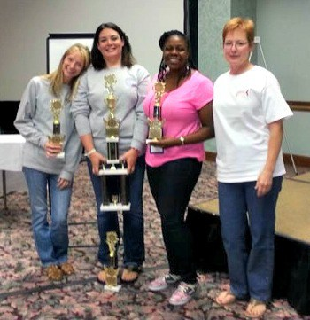 The UAMS team of Lynli Carlin, Lesli Nanny and Alicia Harper join team coach and respiratory care faculty member Theresa Gramlich with their Sputum Bowl 2013 trophy.