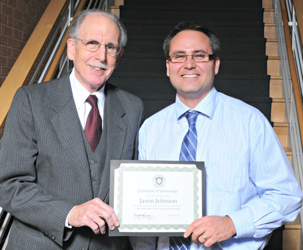 Jason Johnson (right), an audiology student, recipient of the Ronald H. Winters, Ph.D. Endowed Scholarship poses for a photo with College of Health Professions Dean Emeritus Ronald Winters, Ph.D.