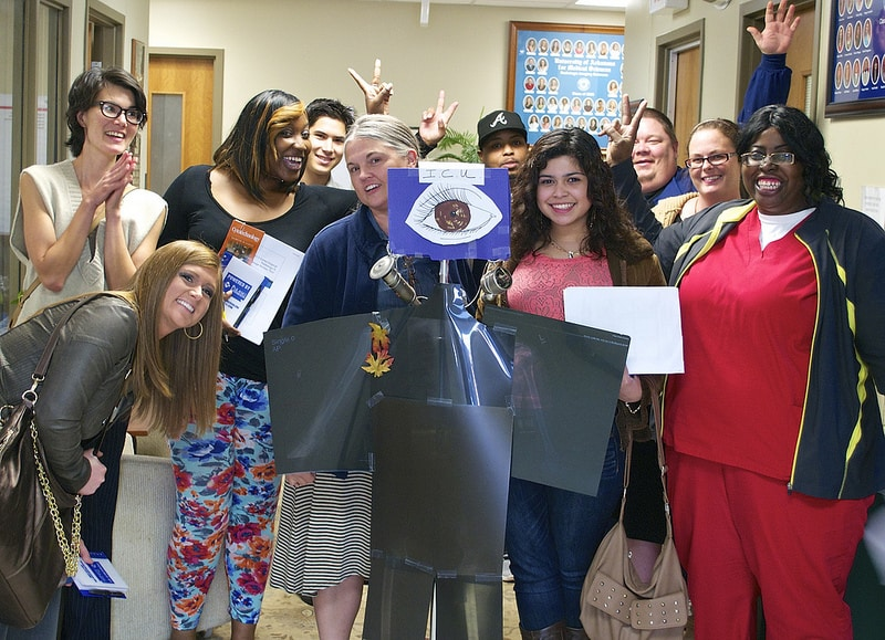"""The group of 10 interns have some fun, posing with """"ICU"""" the unofficial mascot of the College of Health Professions."""