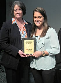 Courtney Byrum (right) receives the 2014 Outstanding Dietetic Intern of the Year from the Arkansas Academy of Nutrition and Dietetics.