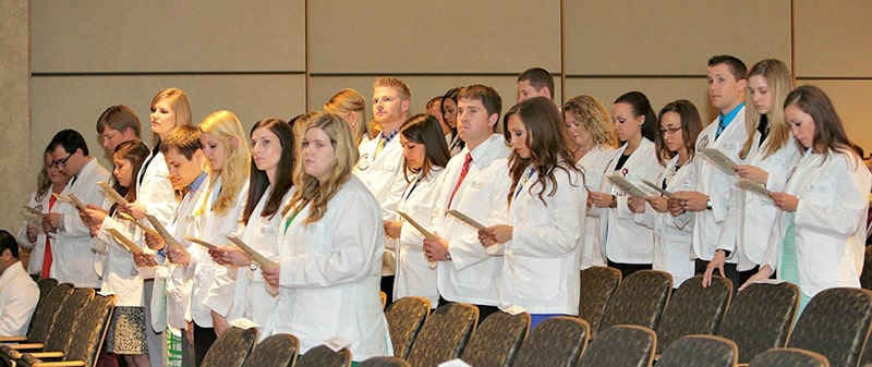 The 30 new physician assistant students recite the Physician Assistant Oath as part of the white coat ceremony beginning their journey in the program.